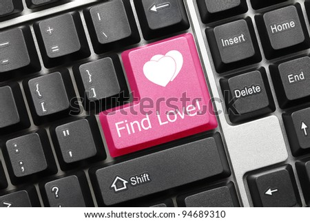 Close up view on conceptual keyboard - Find Love (pink key) - stock photo