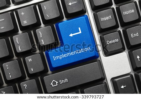 Close-up view on conceptual keyboard - Implementation (blue key) - stock photo