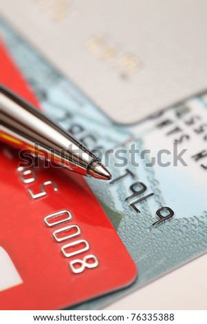 Close up view on credit cards and ballpoint. Business still-life - stock photo