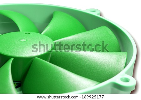 Close-up view on green plastic fan blades of modern personal computer processor cooler. Isolated on white background clipping path included - stock photo