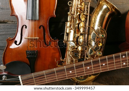 Close up view on musical instruments on wooden background - stock photo