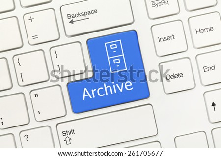 Close-up view on white conceptual keyboard - Archive (blue key) - stock photo