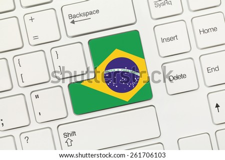 Close-up view on white conceptual keyboard - Brazil (key with flag) - stock photo