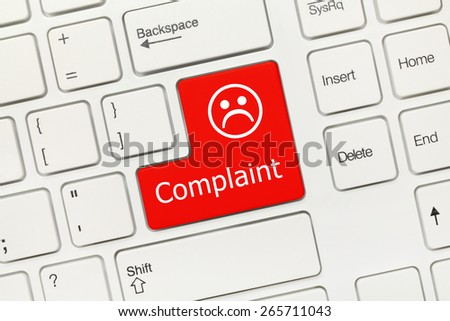 Close-up view on white conceptual keyboard - Complaint (red key) - stock photo