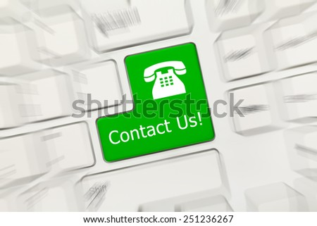 Close-up view on white conceptual keyboard - Contact Us (green key with phone sign). Zoom effect - stock photo