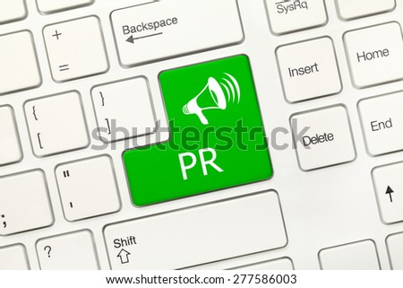 Close-up view on white conceptual keyboard - PR (green key) - stock photo