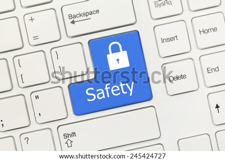 Close-up view on white conceptual keyboard - Safety (blue key) - stock photo