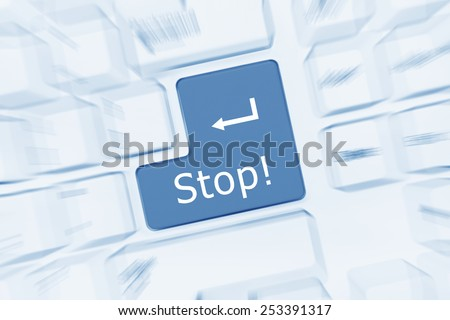 Close-up view on white conceptual keyboard - Stop (blue toned). Zoom effect - stock photo