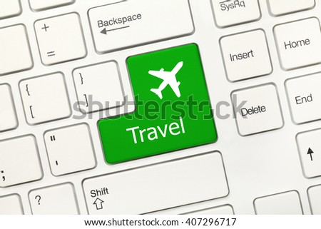 Close-up view on white conceptual keyboard - Travel (green key with airplane symbol) - stock photo