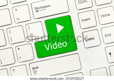 Close-up view on white conceptual keyboard - Video (green key) - stock photo