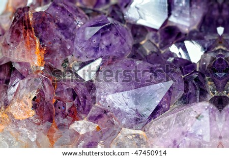 Close-up view to raw amethyst crystals. Studio shot with ring flash - stock photo