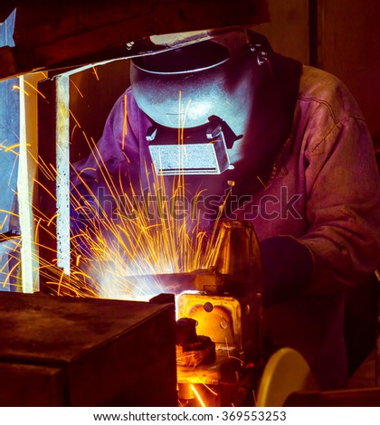 Close up welder Industrial automotive part in factory - stock photo