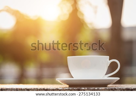 Close up White coffee cup in the park - stock photo