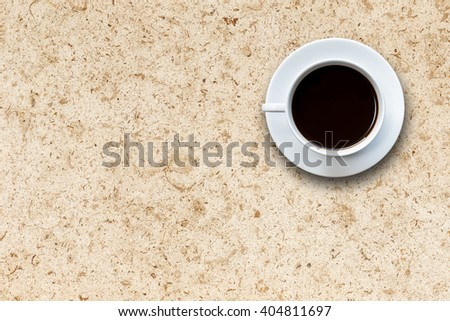 Close up white coffee cup on stone table background top view - stock photo