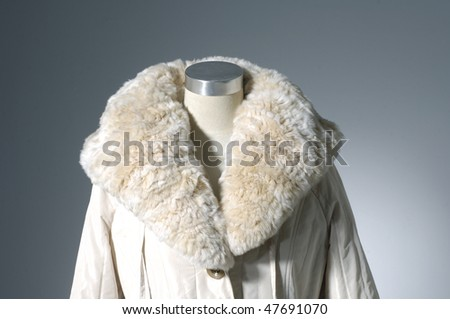 Close up winter coat on display - stock photo