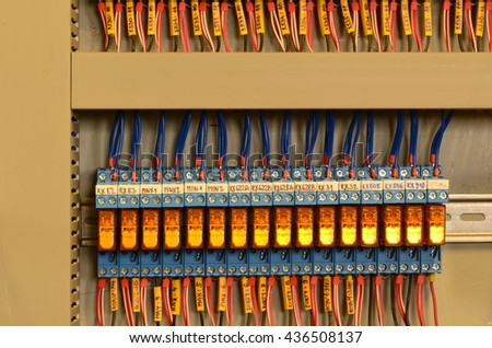 Close up wiring connectors (terminal blocks), multi color wire cables with caption fields. - stock photo