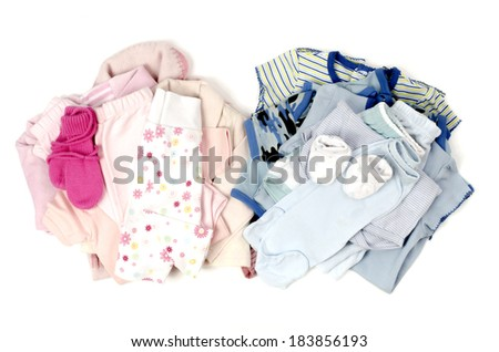 Close up with a blue stack of clean baby clothes for a boy and a pink clean babby clothes for a girl isolated on white - stock photo