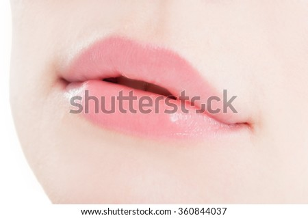 Close-up with natural feminine lips as sensual woman mouth concept - stock photo