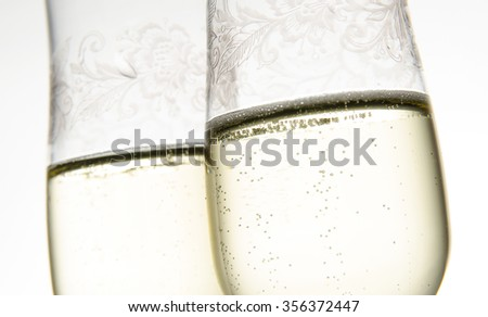 Close up with two glasses of champagne on white - stock photo