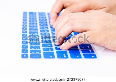 Close up woman finger on blue Thai keyboard cover - stock photo