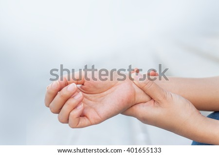 Close up woman holding her wrist, pain concept, Office Syndrome - stock photo