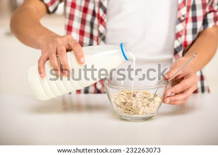 Close-up, woman in the kitchen is preparing breakfast. - stock photo
