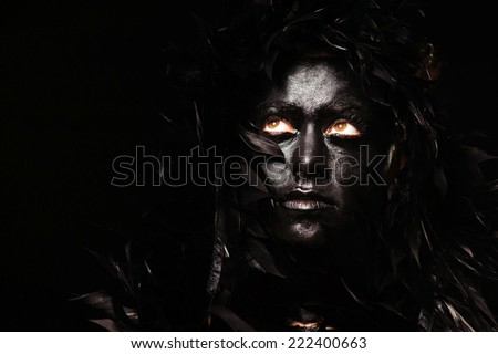 close-up woman portrait with feather hairs - stock photo