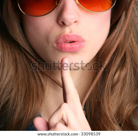 close-up woman portrait with finger near lips - stock photo
