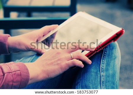 close up woman's hands with tablet - stock photo