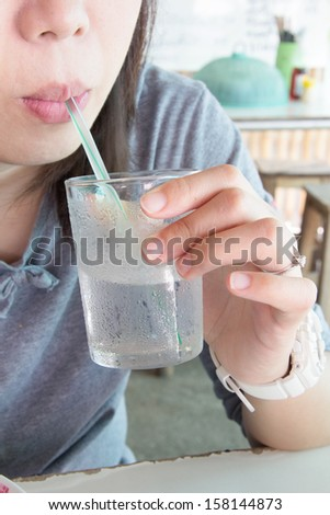 Close-up Woman sipping cold water - stock photo