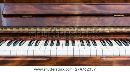 close up wooden piano and white keys - stock photo