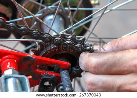 Close up working Hands Removing Bicycle Wheel - stock photo