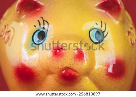 Close up Yellow ceramic piggy bank - stock photo