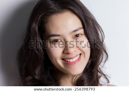 Close up young Asian woman with smiley face. - stock photo