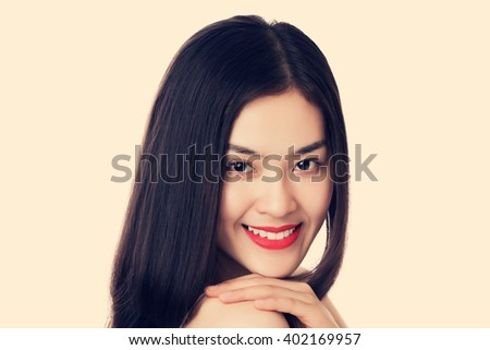 Close up young beautiful Asian woman with happy smiley face, vintage tone color. - stock photo