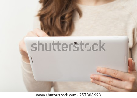Close up young business woman holding tablet pc  - stock photo