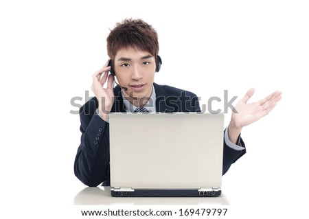 Close up young businessman with headset in office - stock photo
