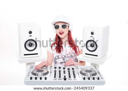 Close up Young Female DJ in Trendy Outfit Mixing Music, Isolated on White Background. - stock photo