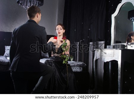 Close up Young Man Proposing to his Girlfriend While at the Bedroom. - stock photo