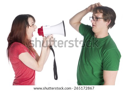 Close up Young Woman Shouting to her Man Scratching his Head with Megaphone, Isolated on White Background. - stock photo