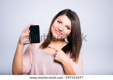 close-up young woman showing her phone - stock photo