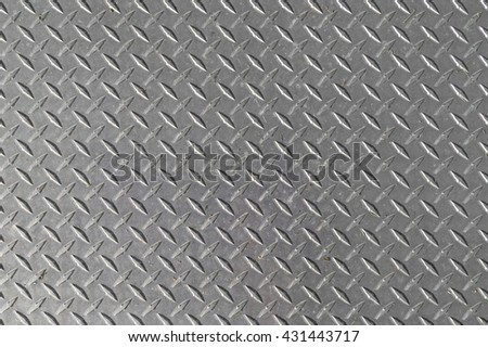 Close view of a galvanized steel plate used for covering construction holes. - stock photo