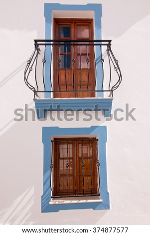 Close view of a typical window from the cubist town of Olhao, Portugal. - stock photo