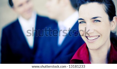 close view of attractive businesspeople smiling and talking - stock photo