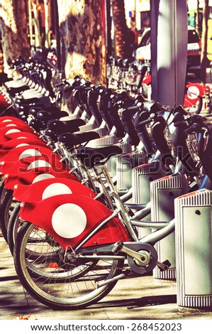 Close view of city bikes in Seville, Spain. Toning effect - stock photo