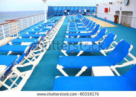 Close view of deck chairs in line - stock photo