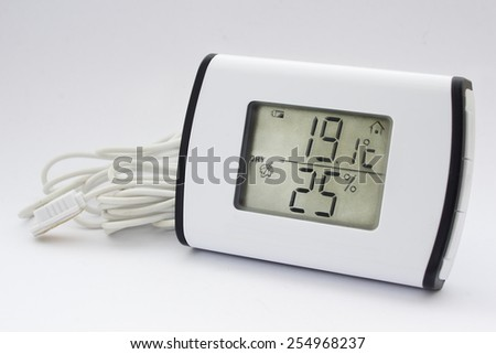 Close view of electronic thermometer hygrometer in a white background - stock photo