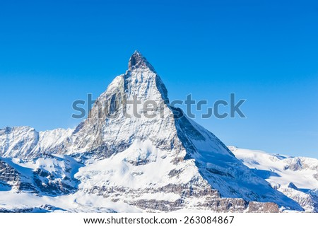 Close view of Matterhorn on a clear sunny day on the winter hiking path, Zermatt, Switzerland. - stock photo