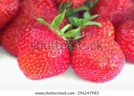 Close view of ripe big strawberries on a white background - stock photo