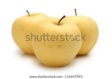 Close view of some tasty yellow apples isolated on a white background - stock photo